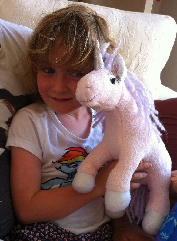 Meg's unicorn, complete with false eyelashes.