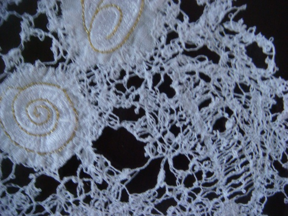 Machined lace . . .  with a feather